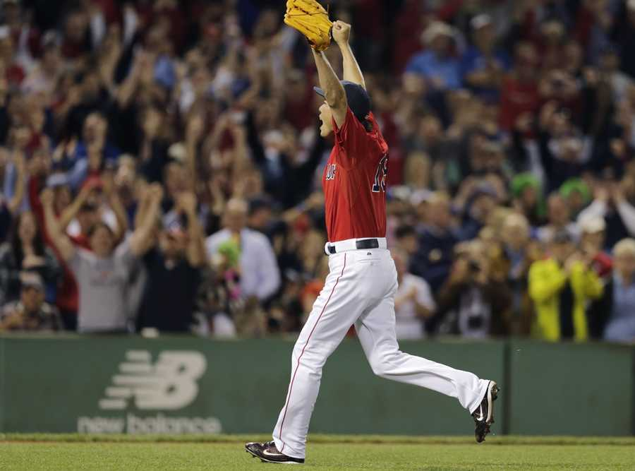 Boston Red Sox relief pitcher Koji Uehara raises his arms as he celebrates the final out after the Red Sox clinched the AL East title with a 6-3 win over the Toronto Blue Jays in a baseball game at Fenway Park, Friday, Sept. 20, 2013, in Boston.