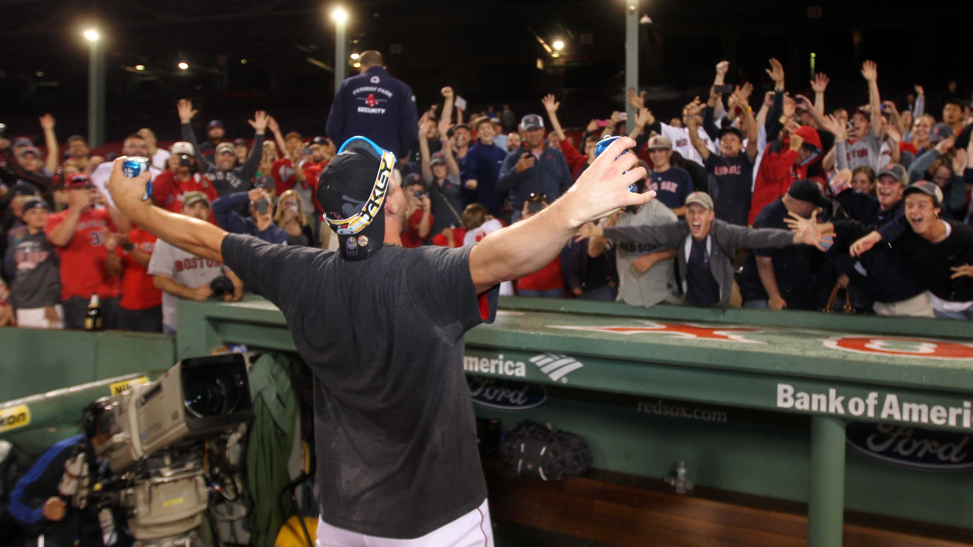 Boston Red Sox catcher Ryan Lavarnway celebrates with fans after the Red Sox clinched the AL East title with a 6-3 win over the Toronto Blue Jays in a baseball game at Fenway Park, Friday, Sept. 20, 2013, in Boston.