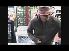He told the clerk to open the cash register drawer.