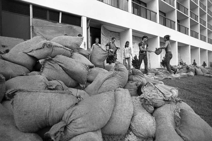 Volunteers form a line to build a sandbag wall in front of a Virginia Beach ocean front hotel on Thursday, Sept. 26, 1985, as Hurricane Gloria moved closer to the east coast.