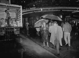Pedestrians carry umbrella as they walk outside Grand Central Terminal as Hurricane Gloria heads toward the city, Sept. 27, 1985, New York. Most schools and many businesses in the city are closed in anticipation of the hurricane.