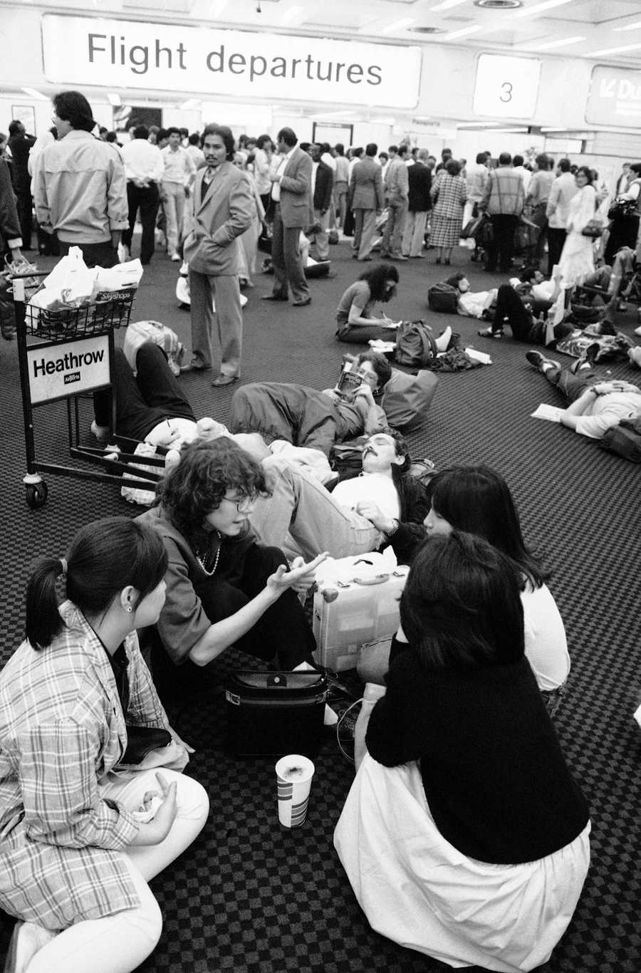 Passengers litter the floor of the departure lounge of London's Heathrow Airport on Friday, Sept. 27, 1985, as flight to the United States were delayed because of Hurricane Gloria battering the US east coast. Some flights face delays of four to six hours, while others were being diverted to other destinations ranging from Florida to Montreal.