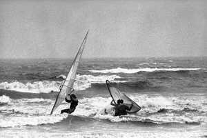 Wind surfers work to keep their boards afloat along the coast of Nahant Beach, Nahant, Massachusetts on Friday, Sept. 27, 1985, as the area bore the affects of Hurricane Gloria.