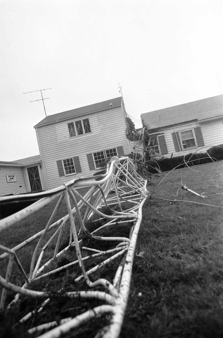 The antenna tower for radio stations WKOK-AM and WVBF-FM lies collapsed over the station facility building on Friday, Sept. 27, 1985 in Framingham, Massachusetts, after it was felled by high winds from Hurricane Gloria.