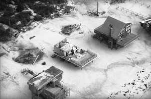 Roofs of houses in Fire Island, New York, were blown away by Hurricane Gloria as it swept through the area, Sept. 28, 1985. Fire Island was especially hard hit as Gloria moved straight across Long Island, leaving behind thousands of downed trees, utility poles and electrical lines.
