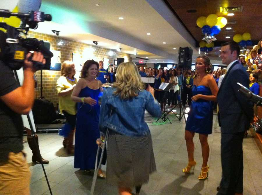 Hundreds turned out to support Sdoia at Fenway's State Street Pavilion Club dressed in marathon blue and yellow.