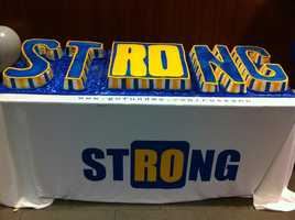 "A Boston Strong cake with Roseann's initials ""Ro"" highlighted."