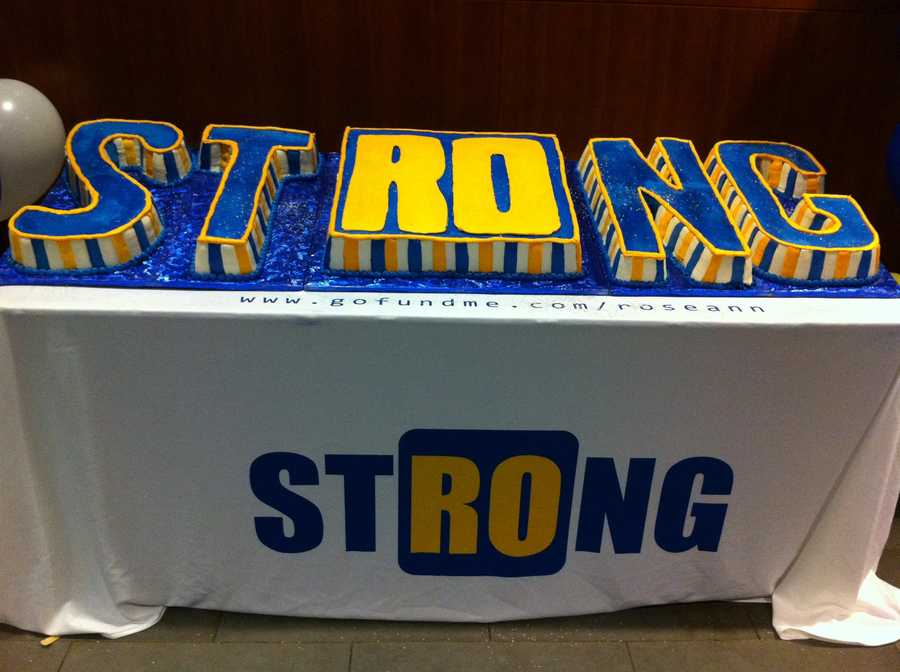"""A Boston Strong cake with Roseann's initials """"Ro"""" highlighted."""
