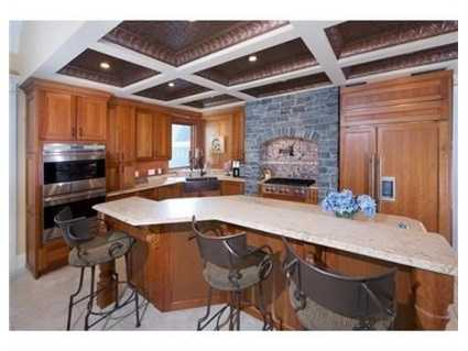 The kitchen features a copper ceiling.