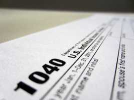 Americans would still have to pay their taxes and file federal tax returns, but the Internal Revenue Service says it would suspend all audits.