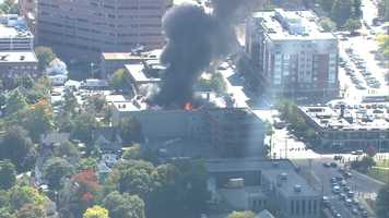 A massive fire ripped through the historic Masonic Temple in Quincy Monday afternoon.