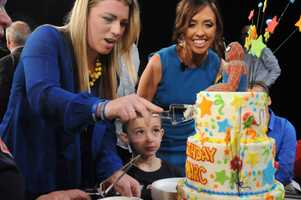 Fucarile's fiancee, Jen Regan, with their son, Gavin, cuts a birthday cake for Gavin and Marc.