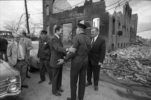 Massachusetts Sen. Edward Brooke tours Chelsea after the fire.