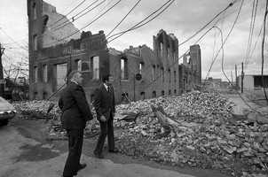 Massachusetts Sen. Edward Brooke and Chelsea Mayor Philip J. Spellman amid the rubble.