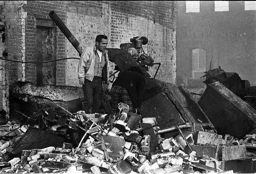 """""""I thought my best photo was taken the day after of people walking through the rubble which looked like a bombed out area,"""" wrote Forman"""