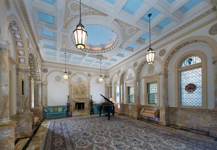 The home features an expansive music room with fluted marble columns where some of the world's greatest musicians and composers performed.