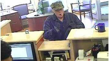 The man entered East Boston Savings Bank at 2172 Massachusetts Ave. shortly after 9 a.m., police said. As he approached the tellers, he pointed a black pistol at them and violently threatened to harm them if they did not comply with his demand for money.