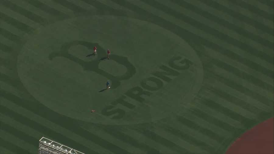 "The Red Sox have cut the ""B Strong"" logo, which also appears on the Green Monster, into the outfield grass at Fenway."