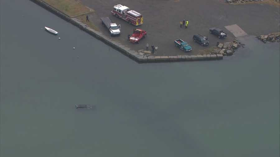 A vehicle plunged into the water off the Stone Pier in Gloucester Friday.
