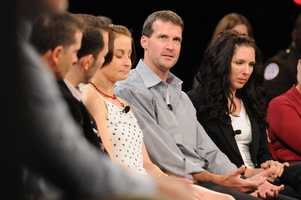 Bombing victims LeeAnn Yanni (L) and Michelle L'Heureux (R) sit with Shane O'Hara, of Marathon Sports, in the center.