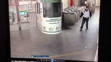 Surveillance video shows two men smashing a window and knocking down a trash can at the Broadway MBTA station.