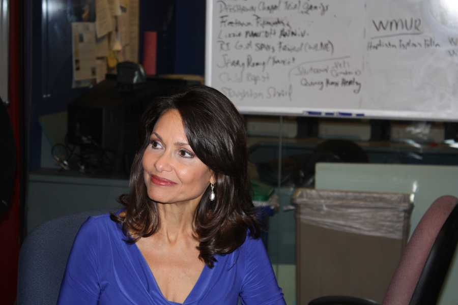 Liz listens in the WCVB newsroom as News Director Andrew Vrees tells the staff of her plans to leave to start her new business.