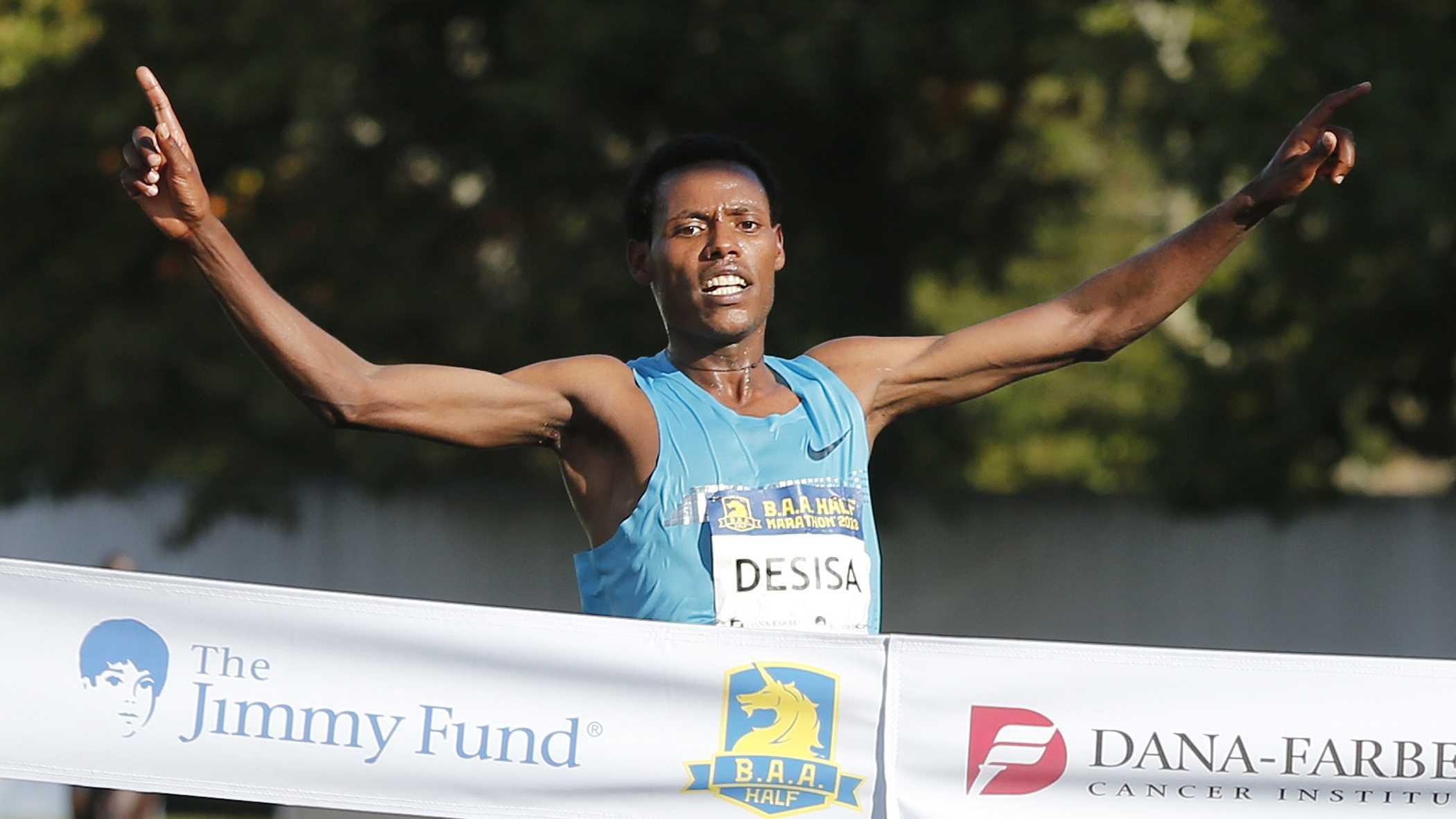 Reigning Boston Marathon champion Lelisa Desisa, of Ethiopia, wins the Boston Athletic Association Half Marathon, Sunday, Oct. 13, 2013.