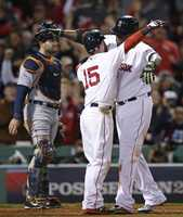 Boston Red Sox's David Ortiz, right, celebrates his grand slam home run with Dustin Pedroia during Game 2 of the American League baseball championship series Sunday, Oct. 13, 2013, in Boston.
