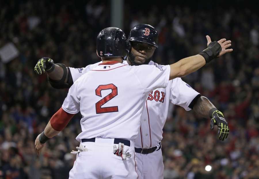 Boston Red Sox designated hitter David Ortiz celebrates with Jacoby Ellsbury after hitting a grand slam home run during Game 2 of the American League baseball championship series against the Detroit Tigers Sunday, Oct. 13, 2013, in Boston.