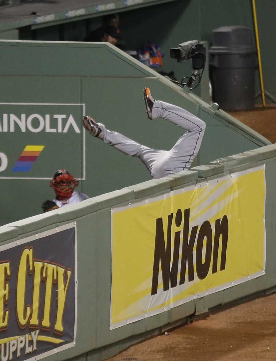 """""""I jumped up. I thought I had a beat on it,"""" said Hunter, who came up in the Minnesota Twins organization with Ortiz and remains friends with the Red Sox slugger. """"Next thing, I know I'm falling over the fence."""""""