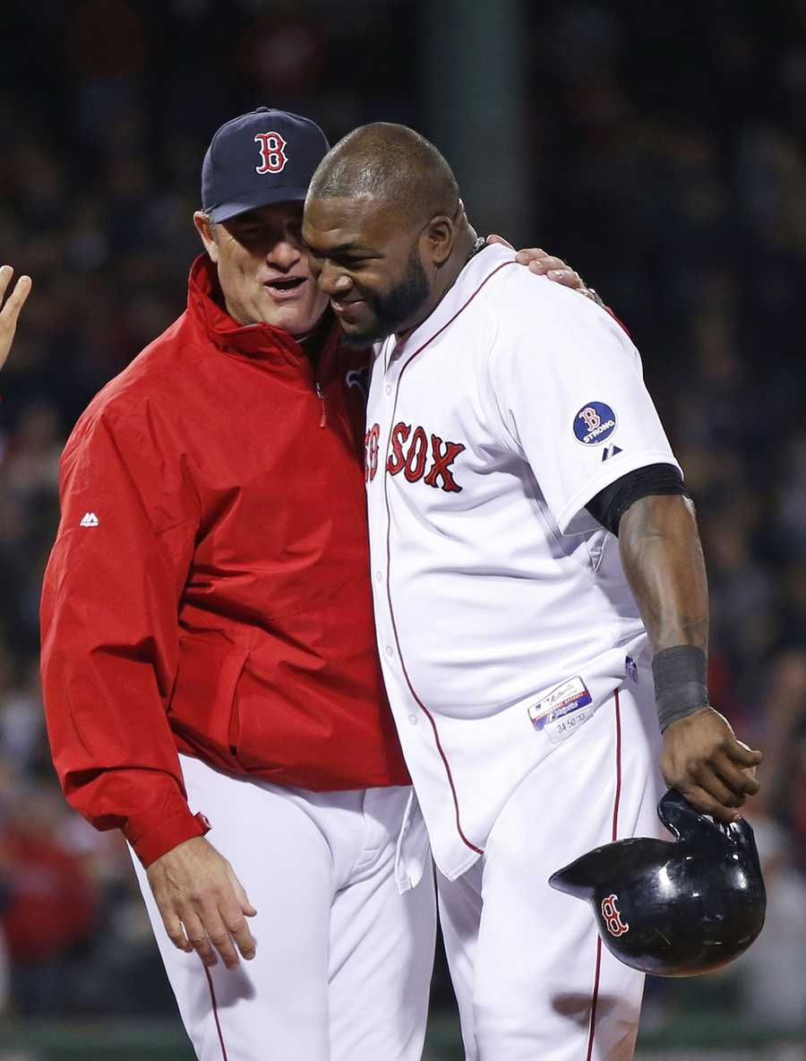 Boston Red Sox manager John Farrell, left, talks with David Ortiz after Game 2.