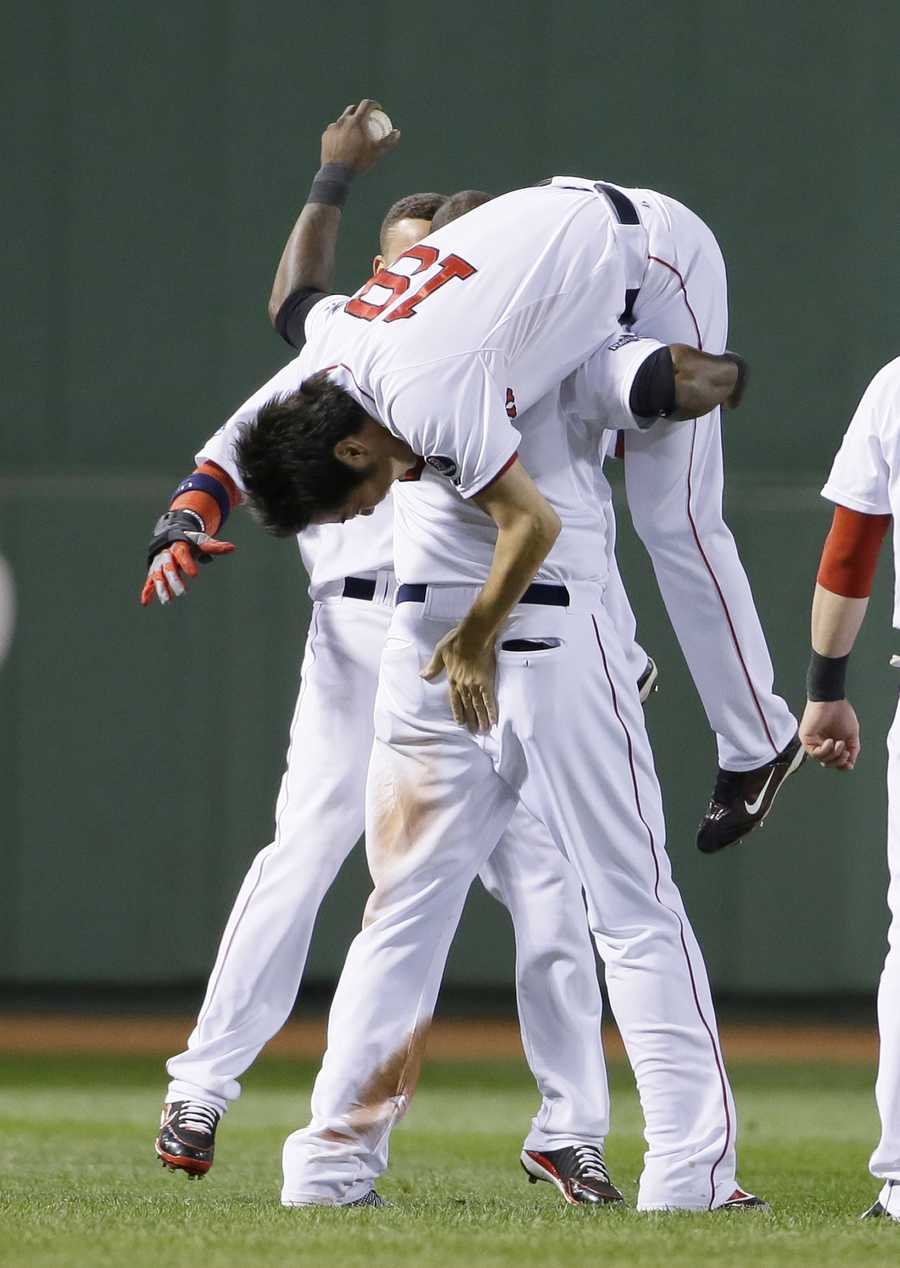 Boston Red Sox's David Ortiz lifts Koji Uehara after Game 2 of the American League baseball championship series against the Detroit Tigers Sunday, Oct. 13, 2013, in Boston. The Red Sox won 6-5.