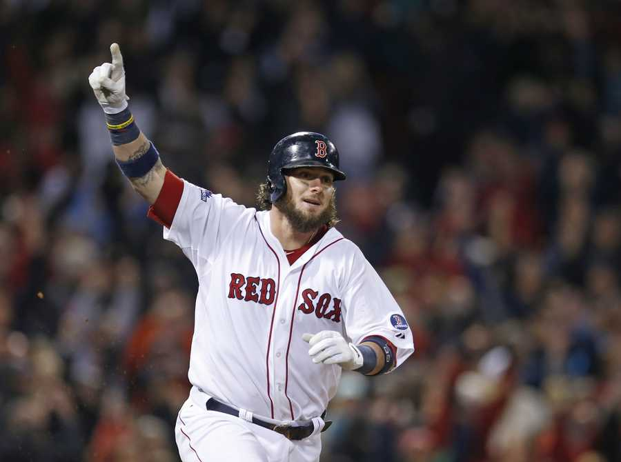 Boston Red Sox's Jarrod Saltalamacchia reacts after hitting the game winning single in the ninth inning during Game 2 of the American League baseball championship series against the Detroit Tigers Sunday, Oct. 13, 2013, in Boston.