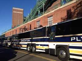 The buses are parked outside Fenway Park, waiting to take the players to the airport for their trip to Detroit.