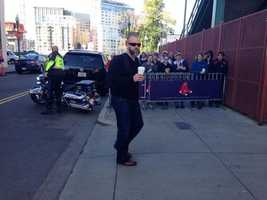 David Ross enjoying some coffee as he arrives at the baseball stadium.