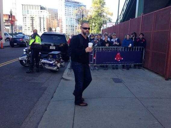 David Ross enjoying some coffee as he arrives at the baseball stadium.