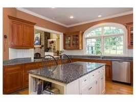 The kitchen opens up to the family room.
