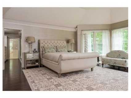 The master suite has a spacious bright bedroom, dressing area and bathroom.