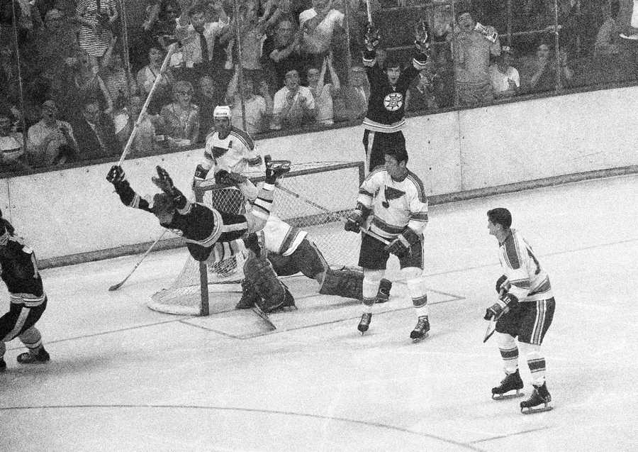 """""""Bobby Orr's Goal""""Bruins' Bobby Orr flies through the air after driving the winning goal by St. Louis Blues' goalie Glenn Hall in the sudden death period of their NHL finals of the Stanley Cup Series in Boston Garden, May 10, 1970. Boston won 4-3 to return the Stanley Cup to Boston for the first time in 29 years."""