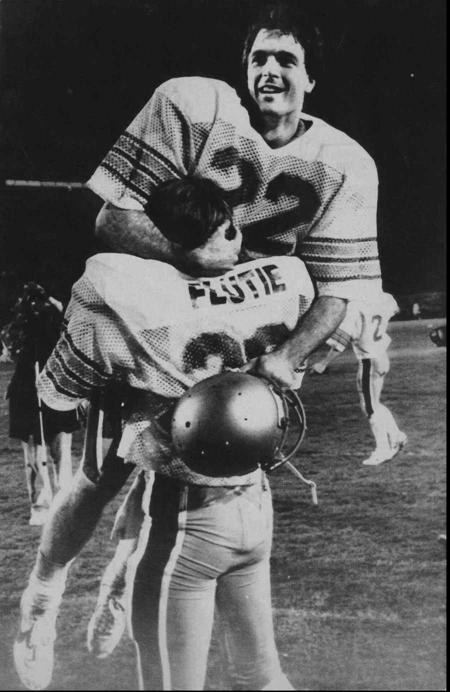 """""""Hail Mary Pass""""Boston College quarterback Doug Flutie rejoices in his brother Darren's arms after B.C. defeated the Miami Hurricanes with Flutie's last-second """"Miracle in Miami"""" touchdown pass to Gerard Phelan in this Nov. 23, 1984 photo."""
