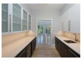 First floor offers Gourmet kitchen with breakfast room, dining room with pantry, living room with fireplace, office with French doors leading to professionally landscaped yard.