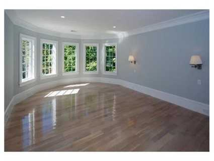 Second floor boasts five bedrooms, including elegant master with marble bath.