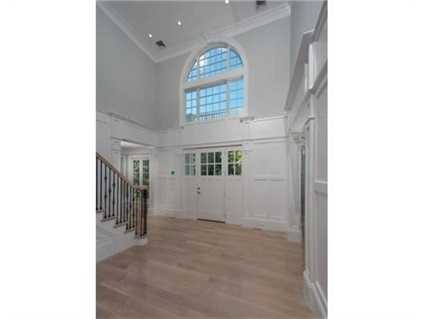 It features a three story foyer with bridal staircase