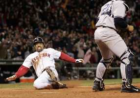 """Roberts Stolen Base""  Dave Roberts slides home to score the tying run against New York Yankees' Mariano Rivera in the ninth inning of game 4 of the ALCS, Oct. 17, 2004, in Boston.  Roberts steal of second base began the greatest comeback in baseball history, where the Red Sox came from 3 games down to defeat the Yankees and advance to the World Series."