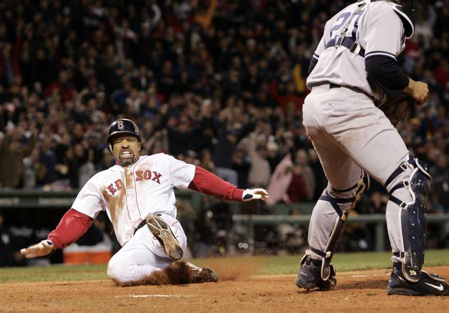 """""""Roberts Stolen Base"""" Dave Roberts slides home to score the tying run against New York Yankees' Mariano Rivera in the ninth inning of game 4 of the ALCS, Oct. 17, 2004, in Boston. Roberts steal of second base began the greatest comeback in baseball history, where the Red Sox came from 3 games down to defeat the Yankees and advance to the World Series."""
