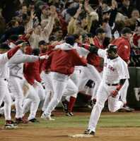 """Papi's walk-off home run""David Ortiz celebrates as he rounds first base after hitting a game-winning home run in the 12th inning against the New York Yankees, of Game 4 of the AL championship series Oct. 17, 2004, at Boston's Fenway Park."