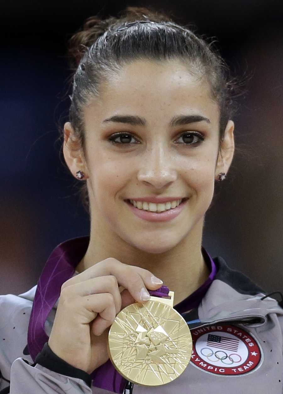"""""""Olympic Gold""""Needham gymnast Alexandra Raisman displays her gold medal during the podium ceremony for the artistic gymnastics women's floor exercise final at the 2012 Summer Olympics, Tuesday Aug. 7, 2012, in London."""