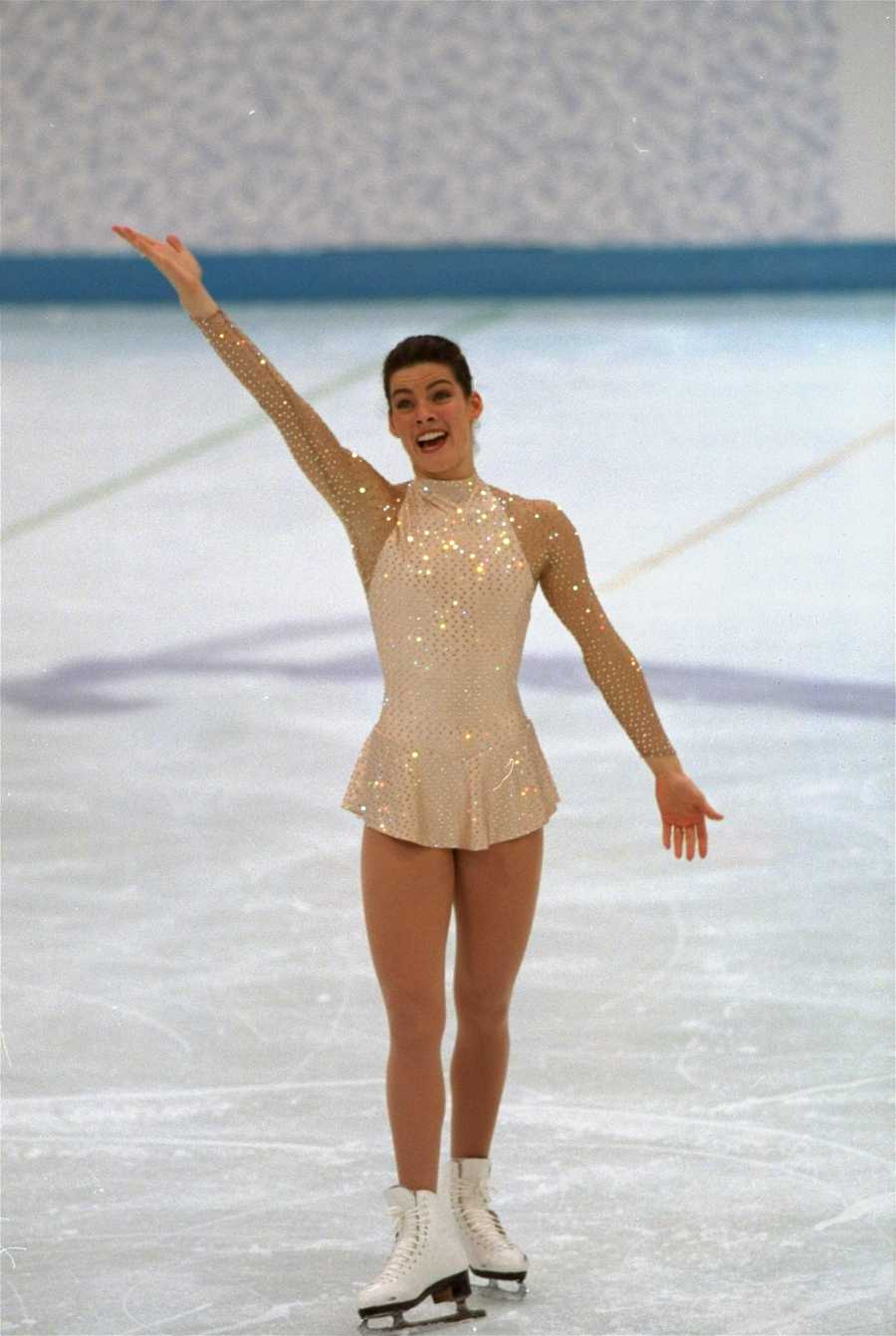"""""""Nancy Kerrigan's Silver Medal""""American figure skater Nancy Kerrigan beams after completing her free skating program, February 25, 1994, in Hamar, Norway. Kerrigan finished in second place to take the silver medal in the Winter Olympics, weeks after she was attacked by friends of rival skater Tonya Harding."""