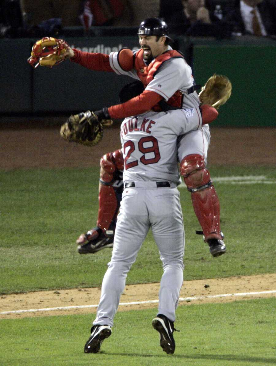 """""""Reverse the Curse""""Catcher Jason Varitek leaps into the arms of pitcher Keith Foulke after the Red Sox beat the St. Louis Cardinals 3-0 to sweep the World Series, Oct. 27, 2004, in St. Louis. It was the first World Series win for the Red Sox in 86 years."""