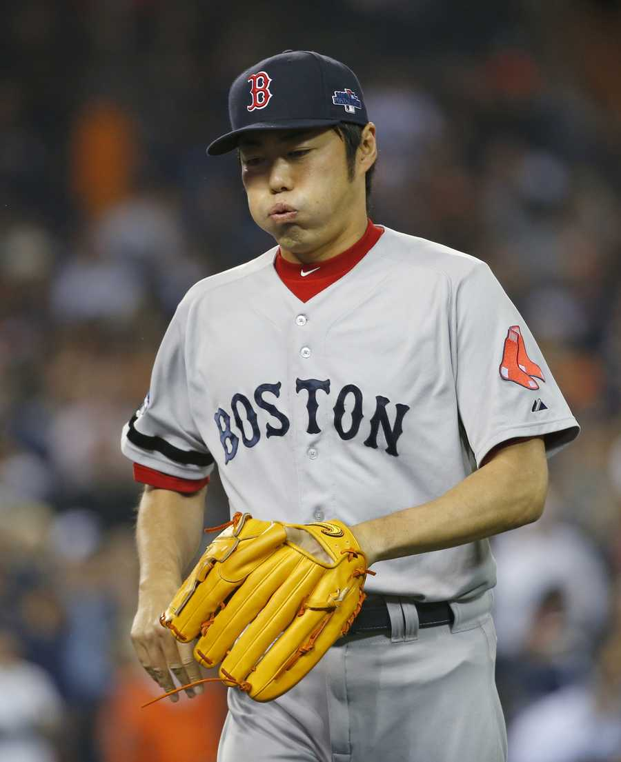 Boston Red Sox relief pitcher Koji Uehara reacts after striking out Detroit Tigers' Prince Fielder to end the eighth inning during Game 3 of the American League baseball championship series Tuesday, Oct. 15, 2013, in Detroit.
